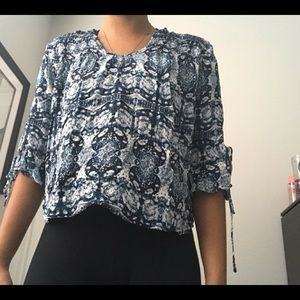 3/4 sleeved flowy wide neck top